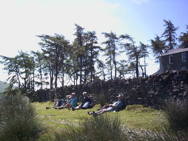 Resting on the Cumbria Way outside Skiddaw House