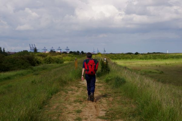 Striding along the sea wall towards Harwich