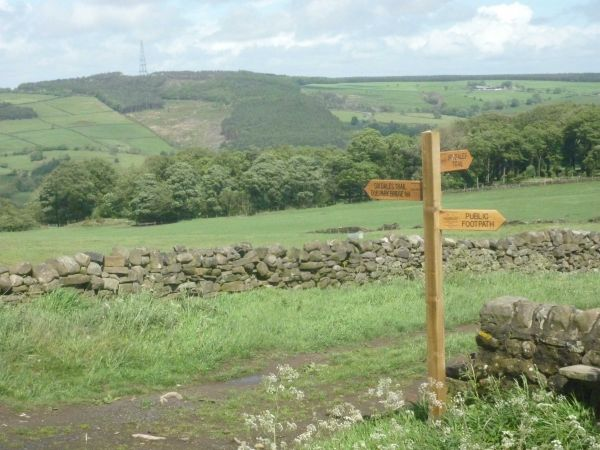 Footpath sign on Six Dales Trail