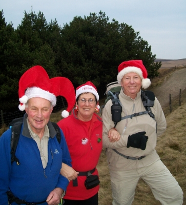 Roger, Viv and Allan with Christmas hats,