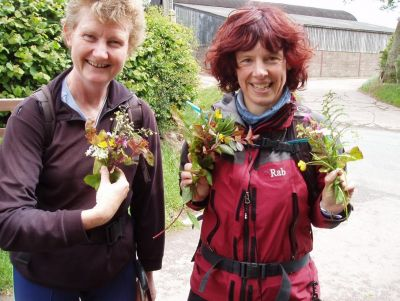 The girls amuse themselves creating roadside verge 'bouquets'.
